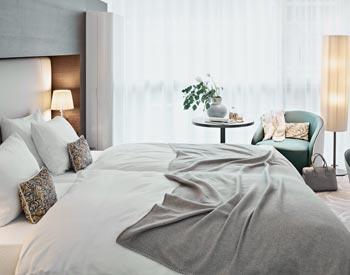 Hotel Deluxe Zimmer Bett